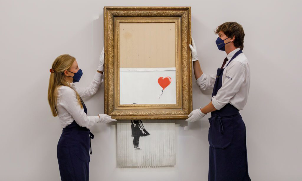 Banksy 被损坏的作品「Love is in the Bin」以创纪录的 1,600 万英镑售出